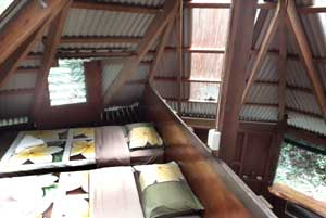 two single beds in the loft of the treehouse